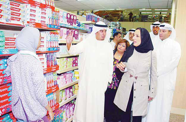 Minister Of Commerce And Industry Amani Buresli (Right), Checks On Commodities At Al Shamiya Cooperative As Ramadan Is Just Around The Corner.